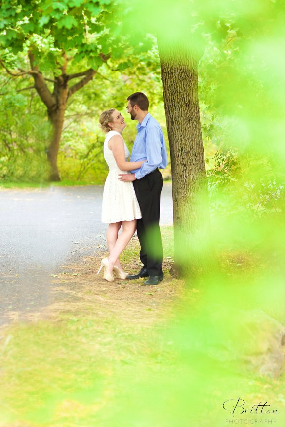 Engagement photo at Manito Park of a couple on a path