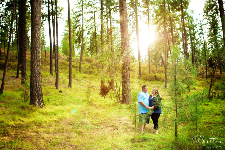 Spokane engagement photo in a forest at Mirabeau Park
