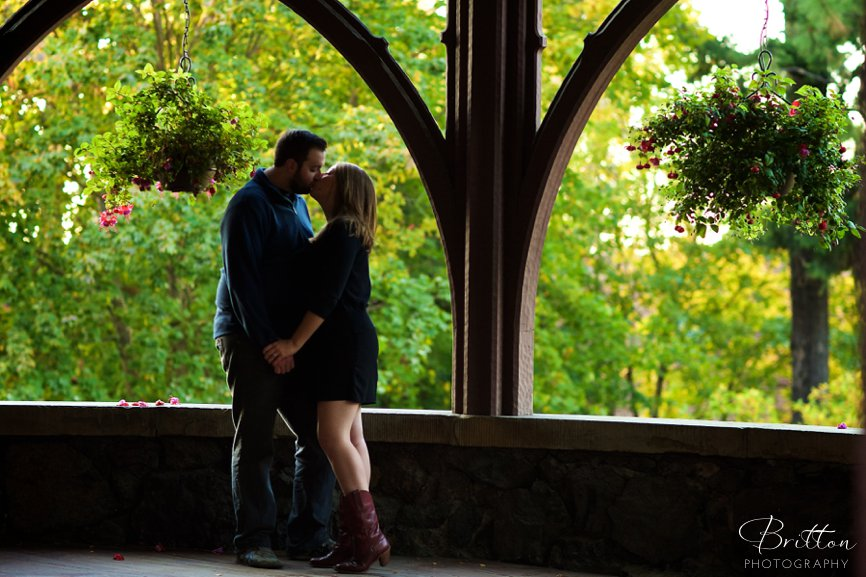 Fall engagement photo of a couple under an arch