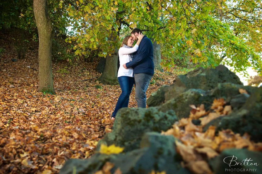 Fall engagement photo of a couple embracing