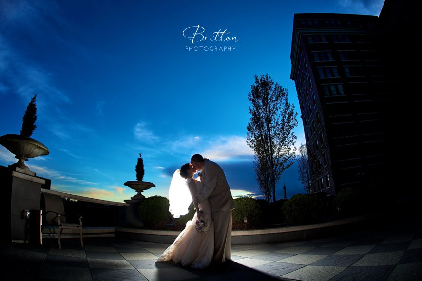 Wedding photo of a bride and groom at night on The Davenport Hotel terrace