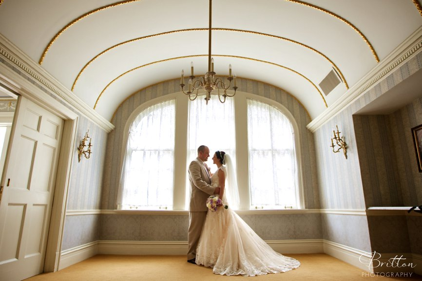 Wedding photo of a bride and groom in a ballroom at The Davenport Hotel
