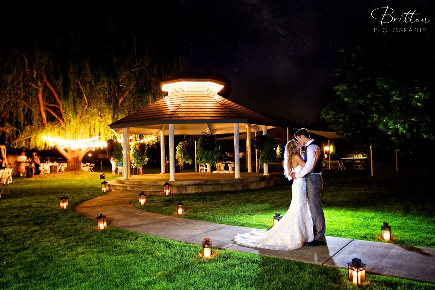 Bride and groom kissing under the stars at Promise Garden