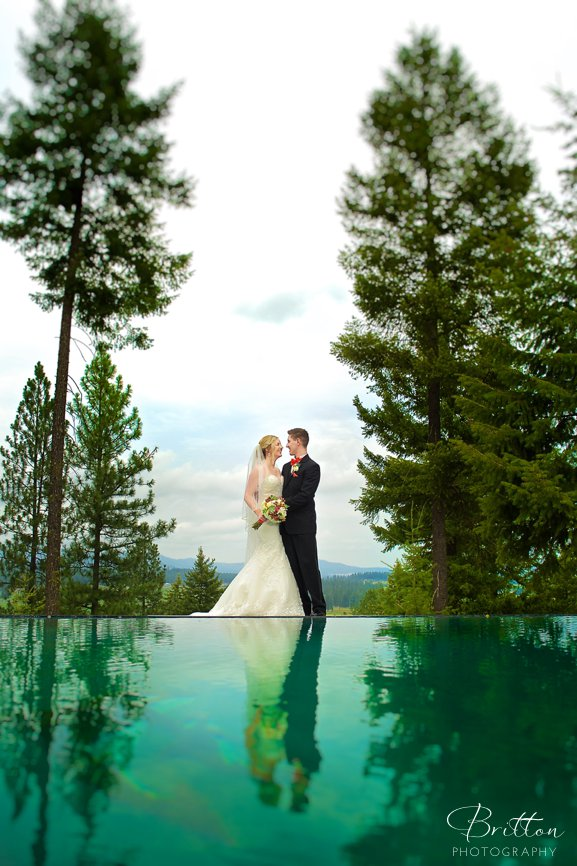 Photo of a bride and groom by the infinity pool at Rocking K Ranch