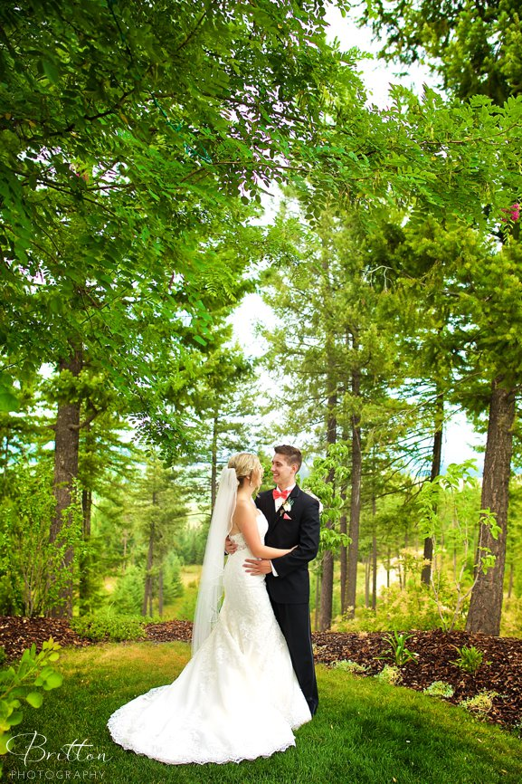 Photo of a bride and groom in a forest clearing at Rocking K Ranch